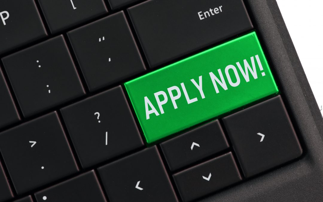 computer-keyboard-with-an-apply-now-key-applying